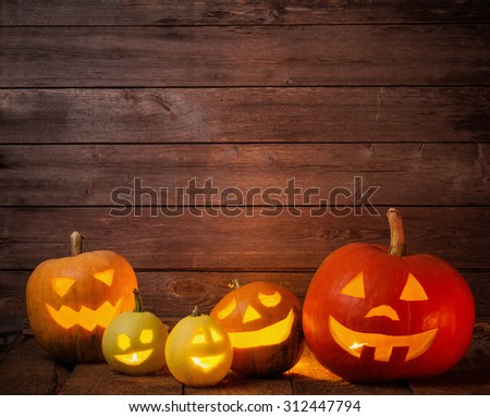 pumpkins on wooden background with copy space - stock photo