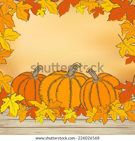 Pumpkins on wooden background with leaves. Autumn background. Mesh background.