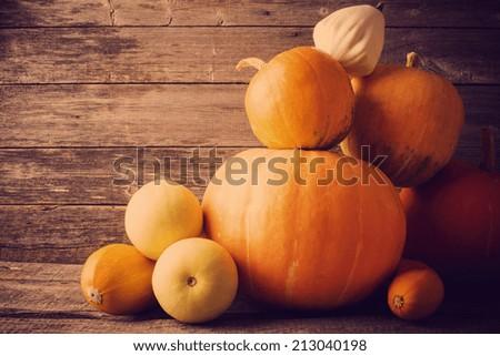 pumpkins on wooden board - stock photo