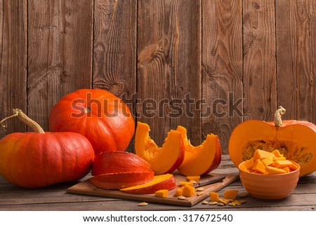 pumpkins on wooden board - stock photo