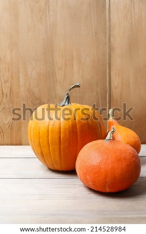 Pumpkins on wooden table, copy space - stock photo