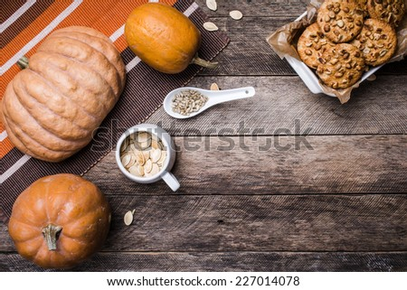 Pumpkins, seeds and  cookies with nuts  on wood in Rustic style. Autumn Season food photo - stock photo