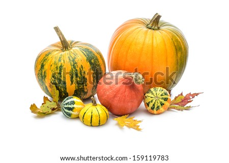 Pumpkins with autumn leaves isolated over white background