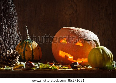 Pumpkins with candle and leafs - stock photo