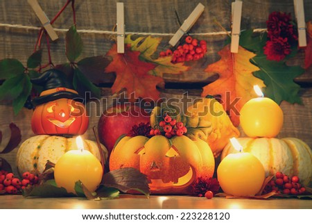 pumpkins with funny faces on dark background - stock photo