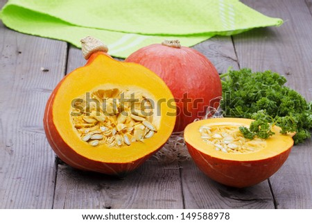 Pumpkins with parsley over wooden background - stock photo