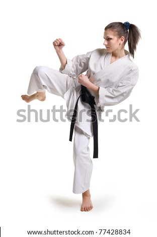 punch.figure in the karate fighting stance on a white background.hand-to-hand fighting