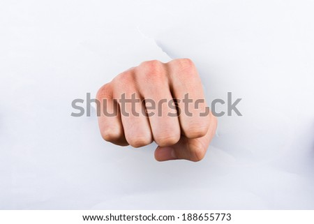 Punch in torn paper, isolated on white background.
