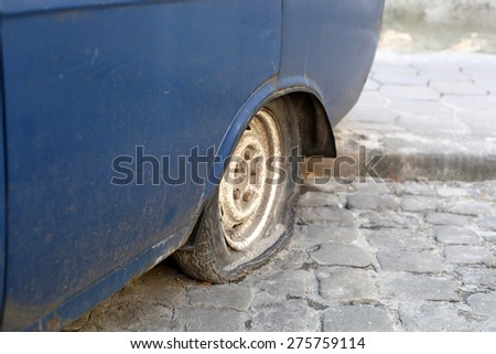 punched a car wheel - stock photo