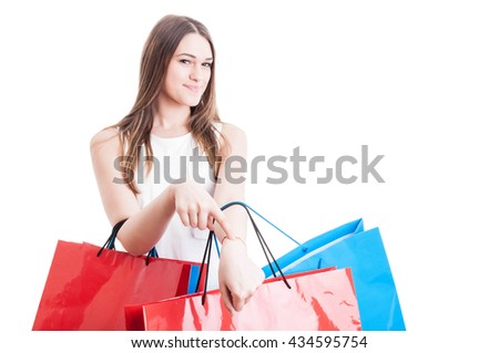 Punctuality concept with smiling beautiful shopaholic showing her wrist and get in time on shopping isolated on white background with copy space - stock photo