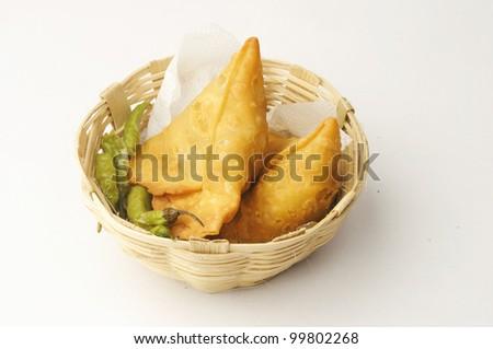 Punjabi Samosa kan basket - stock photo