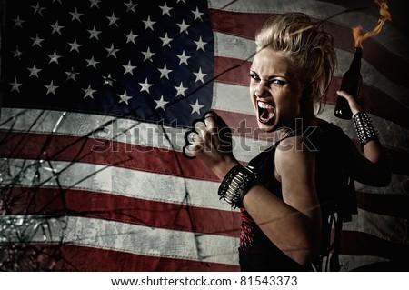 Punk girl behind broken glass. - stock photo