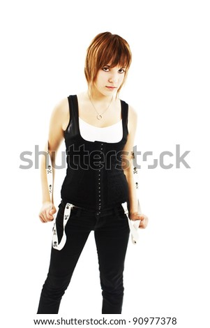 Punk girl wearing pants with suspenders. Isolated on white background - stock photo