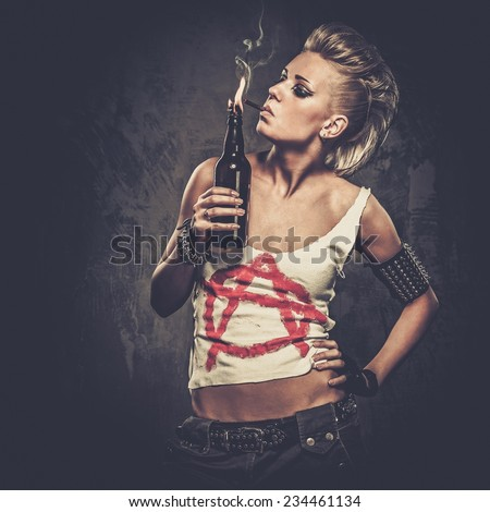 Punk girl with a Molotov cocktail - stock photo