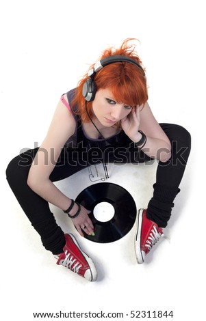 Punk girl with headphones and record