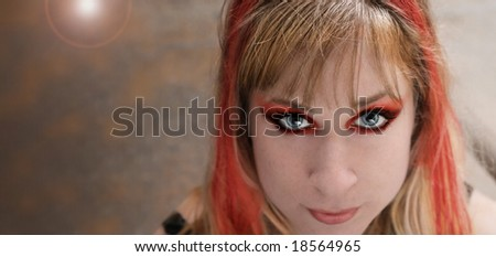 punk rock girl with red hair and make-up