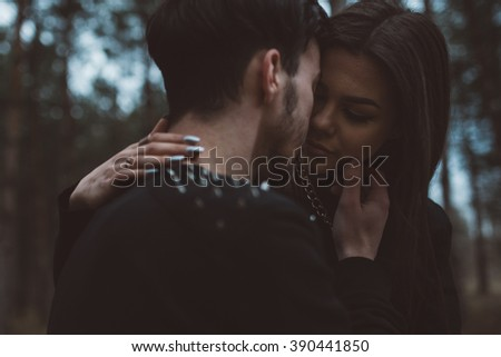 Punks kissing in the woods