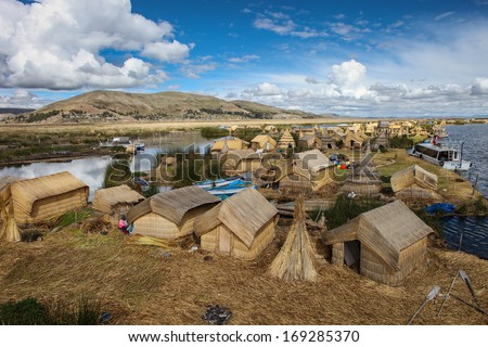 PUNO PERU - JANUARY 18: Uros floating islands on high altitiude lake Titicaca in Puno, Peru on January 18, 2010.   - stock photo