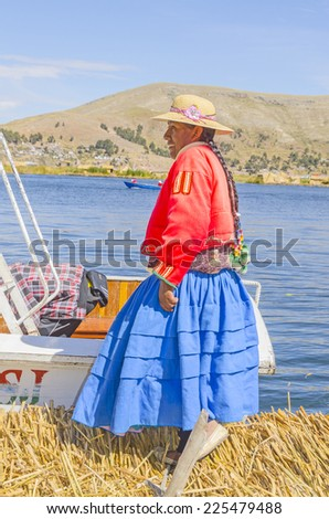 PUNO, PERU, MAY 5, 2014: Local woman in traditional attire at Uros Islands