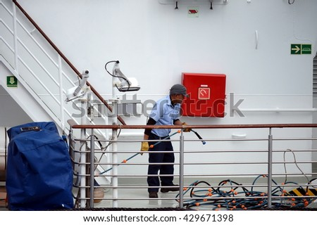 PUNTA ARENAS, CHILE - NOVEMBER 21,2014:The sailor puts things in order on the ship in the port of Punta Arenas.