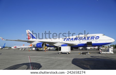 PUNTA CANA, DOMINICAN REPUBLIC - DECEMBER 30, 2014: Transaero Airlines Boeing 747 at Punta Cana International Airport. The Dominican Republic is the most visited destination in the Caribbean  - stock photo