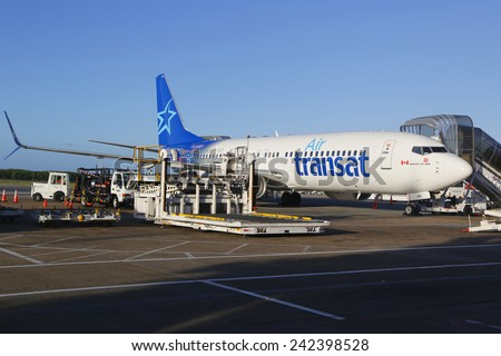 PUNTA CANA, DOMINICAN REPUBLIC - JANUARY 4, 2015: Air Transat airlines Boeing 737 at Punta Cana International Airport. Punta Cana Airport currently serves as a destination for 53 different airlines - stock photo