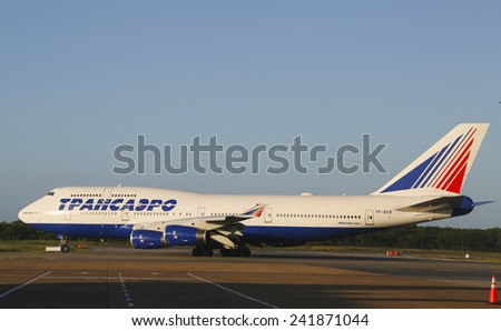 PUNTA CANA, DOMINICAN REPUBLIC - JANUARY 4: Transaero Airlines Boeing 747 taxing at Punta Cana Airport on January 4, 2015. The Dominican Republic is the most visited destination in the Caribbean  - stock photo