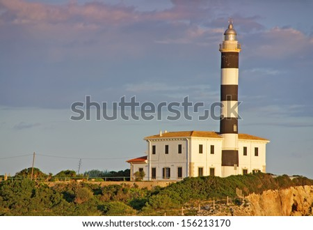 Punta de ses Crestes lighthouse in Porto Colom (Majorca - Spain) - stock photo