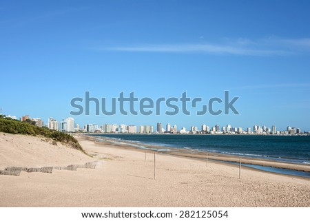 Punta del Este beach with apartment buildings and yacht club in Uruguay, Atlantic Coast - stock photo