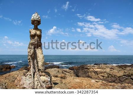 Punta del Este, Uruguay - January 24, 2013: The Mermaids statue by Lili Perkins, at the tip of Punta del Este, Uruguay - stock photo