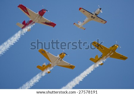PUNTA GORDA, FLORIDA - MAR 21: A group of WWII trainers do a flyby during the Florida International Airshow on March 21-22, 2009