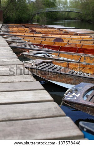 Punting boats in focus in Oxford on a sunny day - stock photo