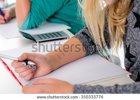pupil copy off of for test in the classroom - stock photo