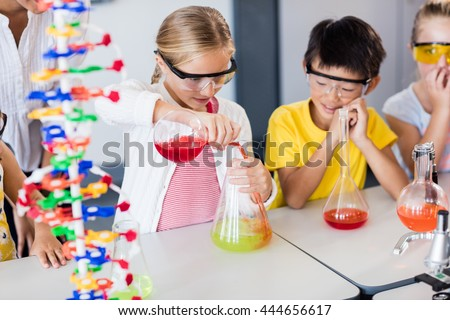 Children science stock images royalty free images vectors pupil doing science while classmates looking her in classroom sciox Gallery