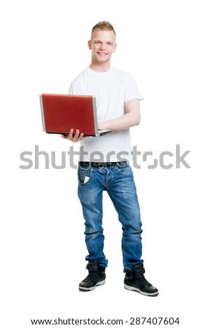 Pupil holding a notebook computer isolated on white - stock photo