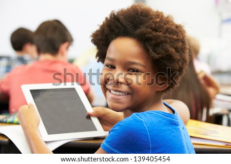 Pupil In Class Using Digital Tablet