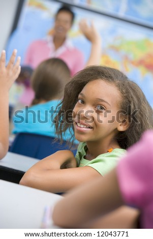 Pupil in elementary school classroom studying geography