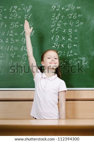 Pupil knows the answer and puts her hand up