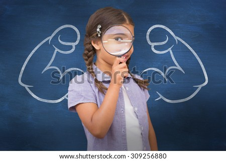 Pupil looking through magnifying glass against blue chalkboard - stock photo