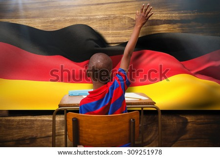 Pupil with the answer against germany flag waving - stock photo