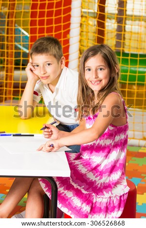 Pupils are very attentive at classes. They listen to every word of teacher - stock photo