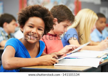 Pupils In Class Using Digital Tablet - stock photo