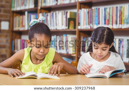 Pupils reading books in the library in school