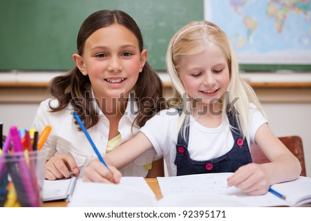 Pupils working together on an assignment in a classroom