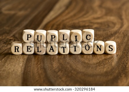 PUPLIC RELATIONS word background on wood blocks