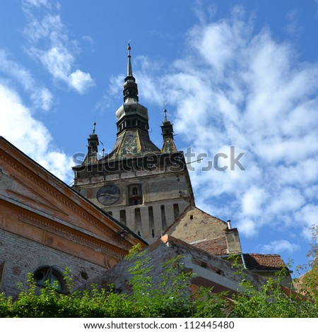 Puppet Clock Tower from Sighisoara, Transylvania, one of the last  still inhabited medieval fortresses in Europe. Sighisoara is also the birth place of Vlad the Impaler, identified as Dracula. - stock photo