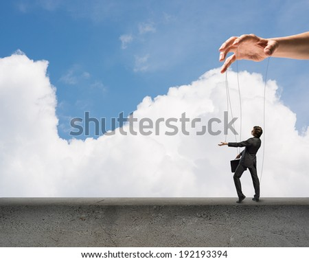 puppet doll business is on the edge, clouds and sky background - stock photo