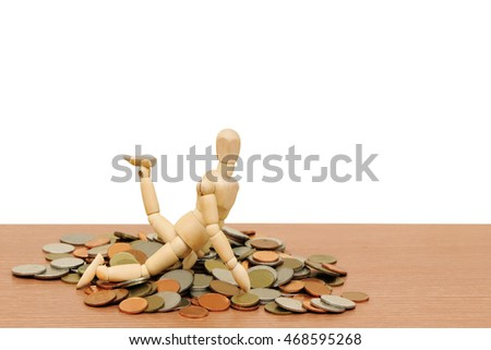 puppet doll on pile of coins ,isolate white background with clipping path