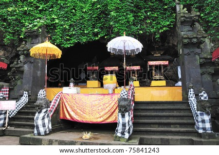 Pura Gua Lawah (bat cave temple), in east Bali. The temple is built surrounding a limestone cave that housed thousands of bats. - stock photo