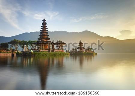 Pura Ulun Danu temple panorama at sunrise on a lake Bratan, Bali, Indonesia - stock photo